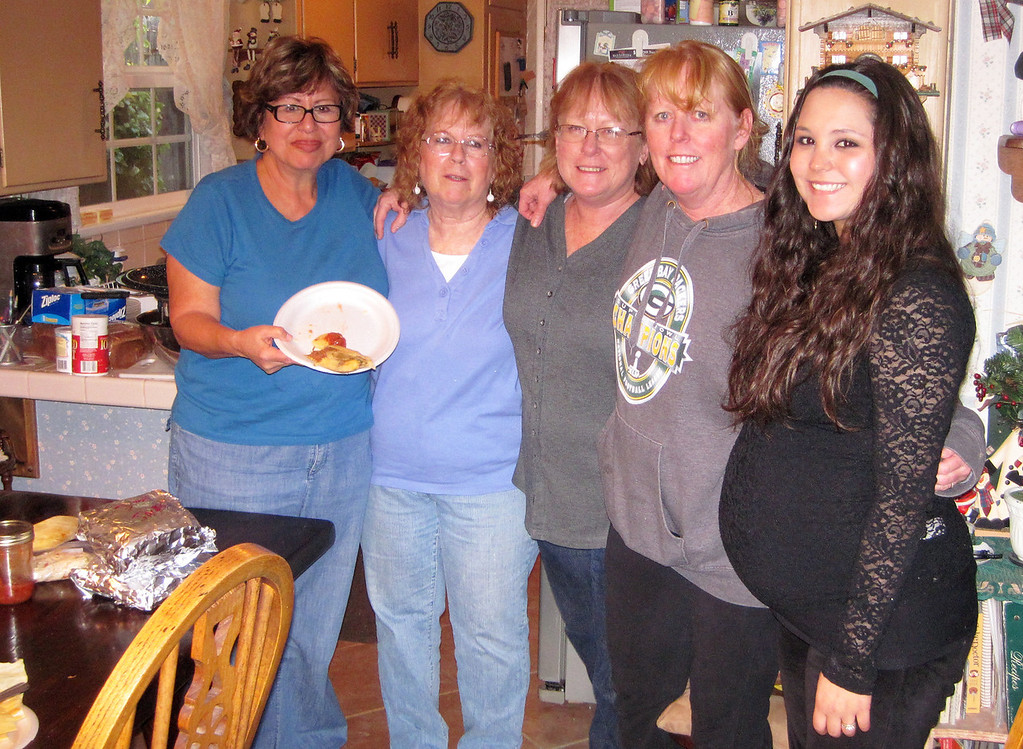 Week 50: A new family holiday tradition -- making tamales. They actually turned out well. From left, Elvia Estrada, Marion, Sharon, Lisa, and our beautiful and very pregnant niece, Emily. (Looking forward to meeting Brayden Matthew Perrine in the new year).