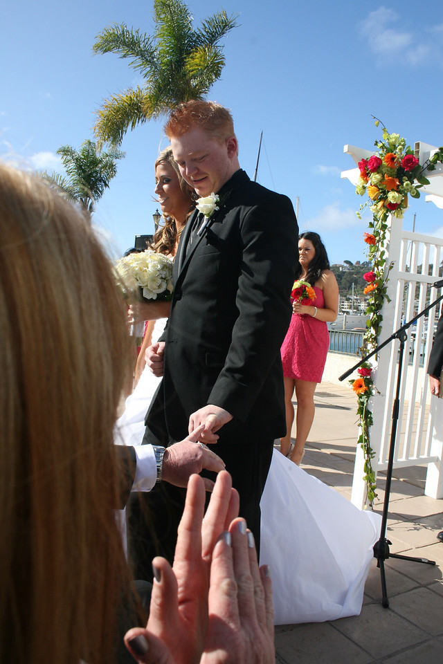 "Week 46: The wedding of the century. Travis and Jill exchange vows on November 19 at the Kona Kai on Shelter Island. I love this shot of Travis giving his dad the ""pinky finger"" which they do for GB touchdowns. Travis just scored the best touchdown of his life."