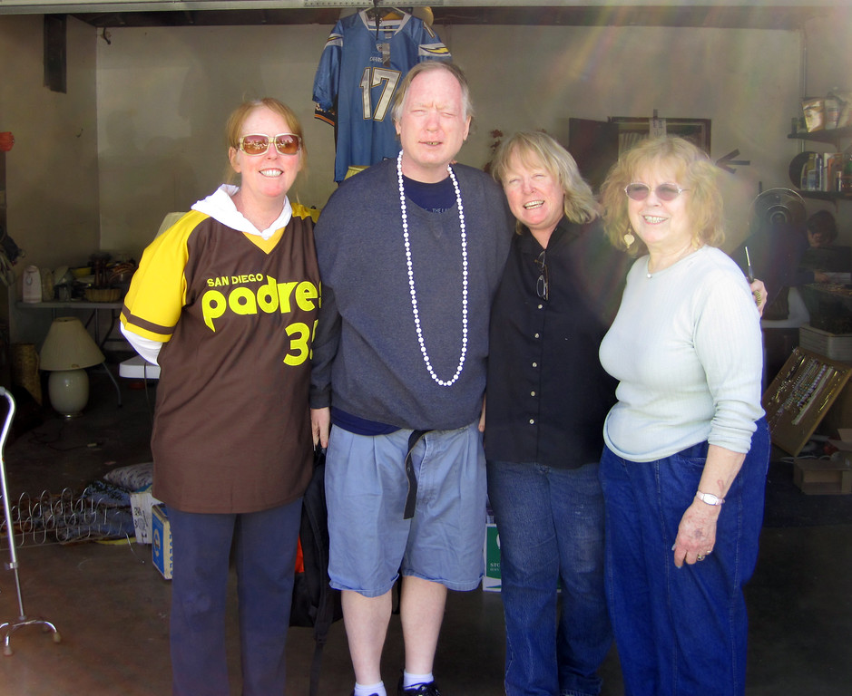 Week 06: The Penny siblings at Momma's garage sale, Feb. 5. I could swear we were inside the garage when this was taken, so the sun spots are rather strange. Perhaps they aren't sun spots but mom and dad showing their presence?