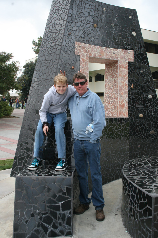 Week 12A: Steve and I took Devan to Explore SDSU on 3/19; here Devan and Steve pose at the 100 Stones Sculpture on campus. We later had lunch at a Thai restaurant near campus.