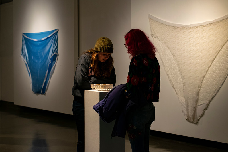Visitors wander Chapman Gallery, surveying the pieces made by Jessiva Levey, Senior in fine arts. (John Chapple | Collegian Media Group)