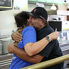Lynn, Ma. 10-8-17. John Drap hugs Carmen Guy upon entering Brother's Deli for the funraiser to aid Puerto Rican victims of Hurricane Maria.