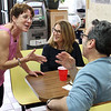 Lynn, Ma. 10-8-17. Cathi Campbell, left, talks with Vivian and Peter Pamel who came down from Montreal, Canada for the fundrasier for Hurricne Maria victims held at Brother's Deli on Sunday.