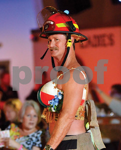 A firefighter stands proud in a Texas-themed bra. (Victor Texcucano)