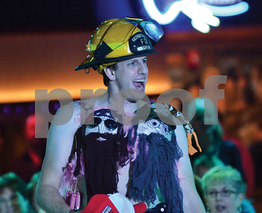 "A ""Duck Dynasty""-themed bra is displayed by a firefighter during the Bras for the Cause event, held Tuesday night at Cowboys on Paluxy Drive. Volunteer and city firefighters strutted down a runway with bras designed and donated by local businesses as part of an auction benefitting the Susan G. Komen Foundation and the Women's Council of Realtors. Guests bid on the bra, as well as a goodie baskets worth up to $250. (Victor Texcucano)"