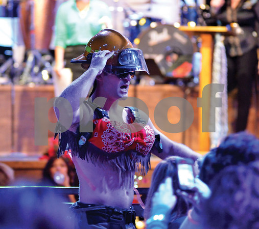 A firefighter struts in a frilly cowboy bra. (Victor Texcucano)