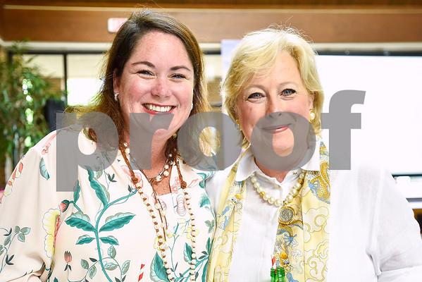 Kelley Brownlow and Cynthia Riter pose for a photo during a fundraiser for the renewal of the original entrance to the Rose Garden, hosted by the Gertrude Windsor Garden Club at the Rose Garden Center in Tyler, Texas, on Thursday, April 20, 2017. (Chelsea Purgahn/Tyler Morning Telegraph)