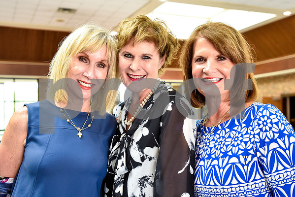 Laura Brown, Charlotte Owen and Nancy Clawater pose for a photo during a fundraiser for the renewal of the original entrance to the Rose Garden, hosted by the Gertrude Windsor Garden Club at the Rose Garden Center in Tyler, Texas, on Thursday, April 20, 2017. (Chelsea Purgahn/Tyler Morning Telegraph)