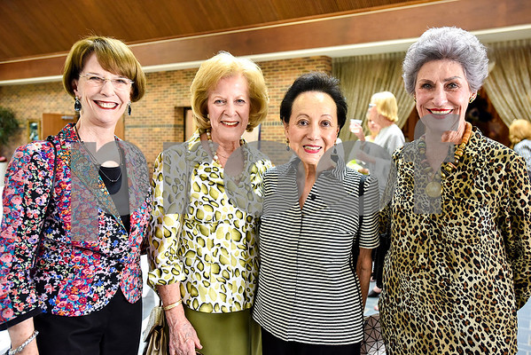 Flora Wilson, Brenda Gregory, Amy Faulconer and Cecil Ward pose for a photo during a fundraiser for the renewal of the original entrance to the Rose Garden, hosted by the Gertrude Windsor Garden Club at the Rose Garden Center in Tyler, Texas, on Thursday, April 20, 2017. (Chelsea Purgahn/Tyler Morning Telegraph)