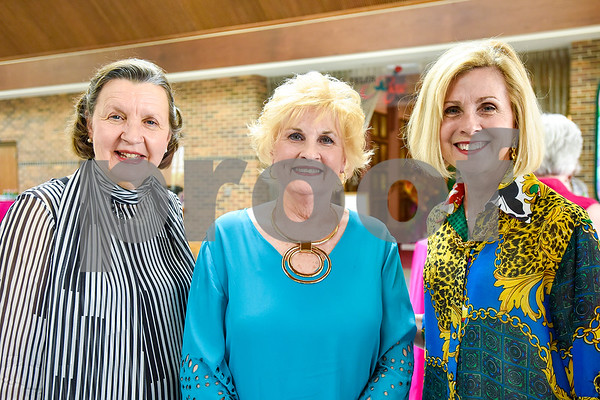 Kathy Babin, Lynn Heines and Deborah Smith pose for a photo during a fundraiser for the renewal of the original entrance to the Rose Garden, hosted by the Gertrude Windsor Garden Club at the Rose Garden Center in Tyler, Texas, on Thursday, April 20, 2017. (Chelsea Purgahn/Tyler Morning Telegraph)