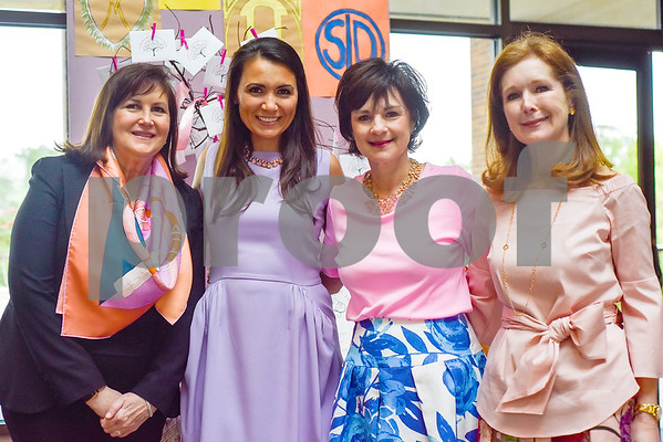 Teresa Thrash, Kimberly Schlegel Whitman, Mary Lauren Faulkner and Lanette Lehneftz Smith pose for a photo during a fundraiser for the renewal of the original entrance to the Rose Garden, hosted by the Gertrude Windsor Garden Club at the Rose Garden Center in Tyler, Texas, on Thursday, April 20, 2017. (Chelsea Purgahn/Tyler Morning Telegraph)
