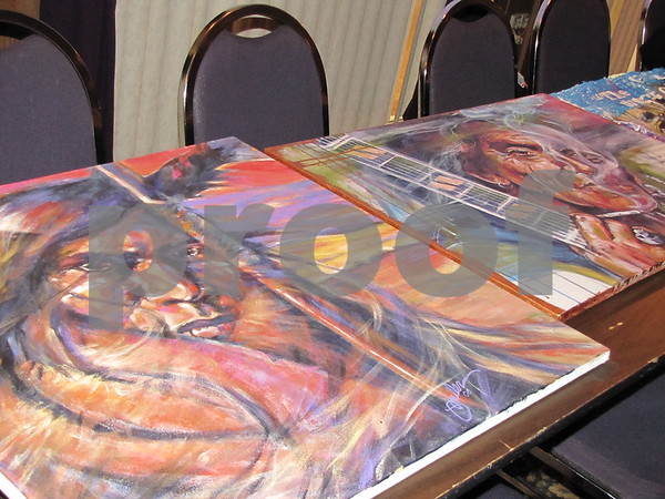 """Paintings up for auction at the Alzheimer's fundraiser """"A Concert to Remember""""."""