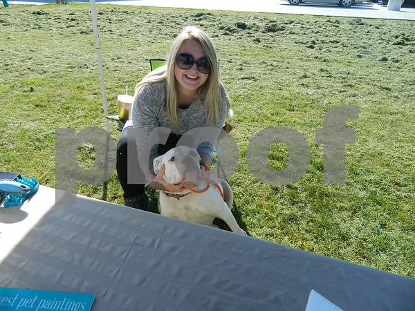 Kara Berhow bonding with a dog up for adoption