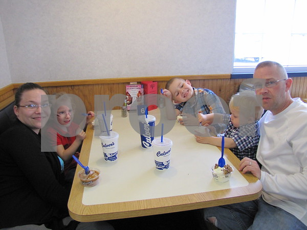Julie and John Hanson and family enjoy a meal at Culvers in support of the Almost Home animal shelter.