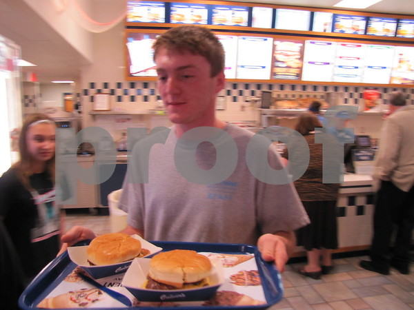 Spencer Batcheller serves food at Culvers as part of the fundraiser for Almost Home.
