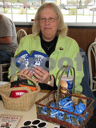 Cindy Larson is the secretary on the Almost Home board, and also a volunteer at the animal shelter.  She shows a few items the shelter had for sale.