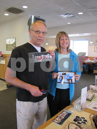 John and Dee Larson support the Almost Home animal shelter by purchasing some items at the benefit.