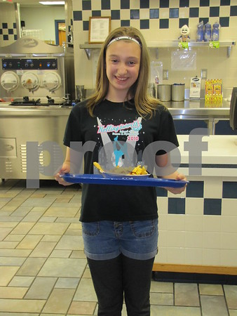 Marissa Smith, a volunteer for Almost Home animal shelter, serves food to customers while working at the fundraiser held at Culvers restaurant.