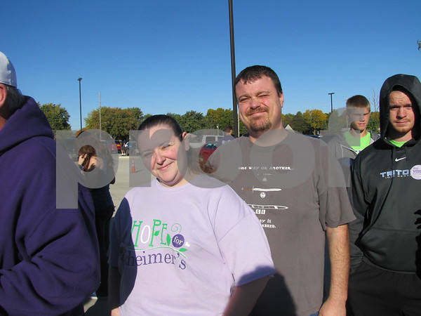 Amanda Sigler and Tony Sanders wait in line to register for the Alzheimer's Walk.
