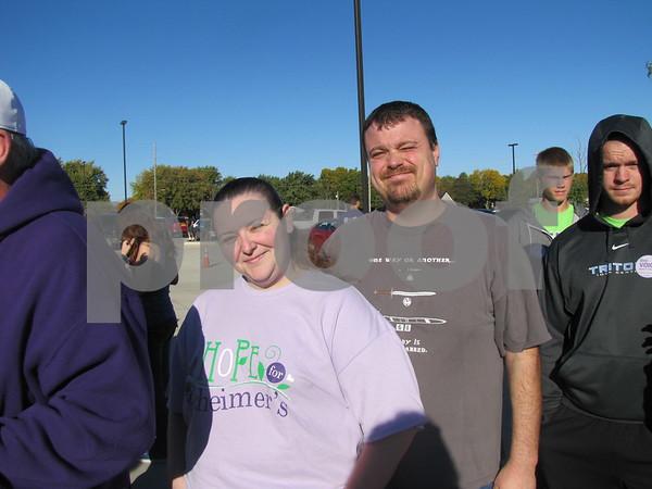 Amanda Sigler and Tony Sanders wait in line to register for the Alzheimer's Walk.