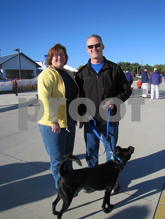 Rhonda and Jim Guldenfennig and their dog, Mo.