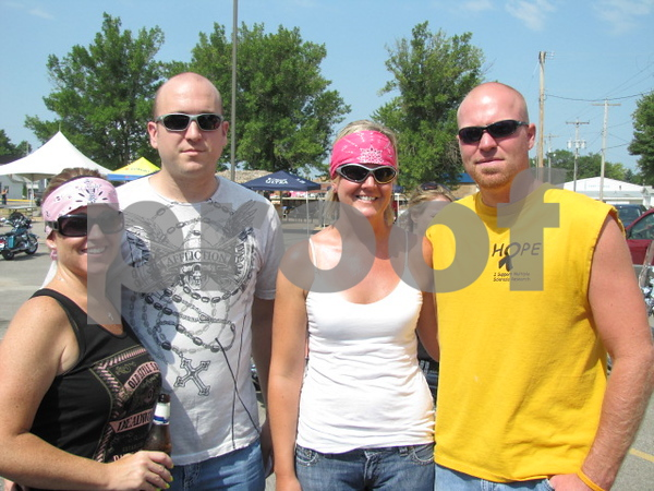 Jamie and Craig Schlienz, and Jennifer and Chad Sadler before the 'Angel Ride' began.