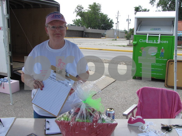 Pat Hassett watched over the silent auction items at the 'Angel Ride' event held at the Community in Fort Dodge.
