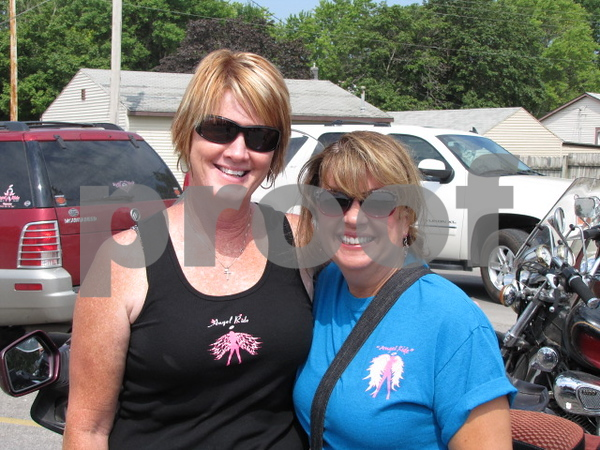 Karen Little and Ann Payne pose before starting off on the 'Angel Ride' to save the tatas.