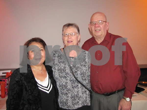 Tuyen Foreman, and Betty and Leroy Hartquist