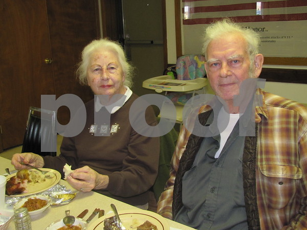 Bonnie and Harold Messerly pause will enjoying their pork chop dinner at the VFW Post 1856 in Fort Dodge.