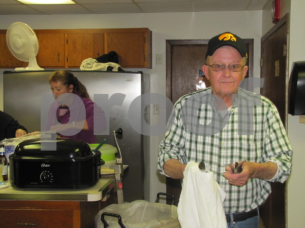 Al Geerdes does his part by doing dishes at the VFW Post 1856 Pork Chop Dinner.