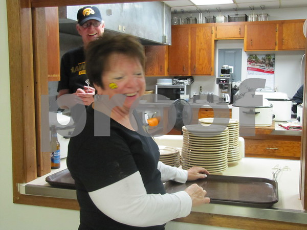Kay Arends was serving dinners to attendees at the VFW Pork Chop Dinner held at Post 1856.