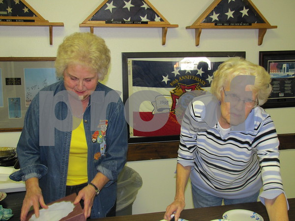 Karen Vosberg and Doris Grell of the VFW Auxiliary serve up homemade pie at the Post 1856 Pork Chop Dinner.