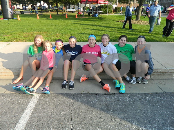 Left to right: Devyn Scott, Claire O'Connor, Abby Landwehr, Jacque Oberg, Nichole Kane, Macey Mason, Natalie Nordstrom, and Jillian Cosgrove.