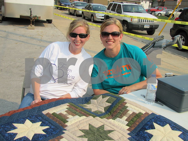 Amanda and Abie Seltz with the quilt for the silent auction at the Ava Passow Charity Grill-off.