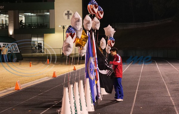 T. K. Gorman Cheerleader looks at an M.I.A. flag