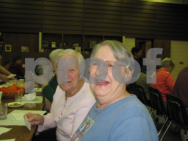Iona Gathman and Lois Udermann share a laugh at the Election Night Soup and Pie Supper at First Congregational UCC.