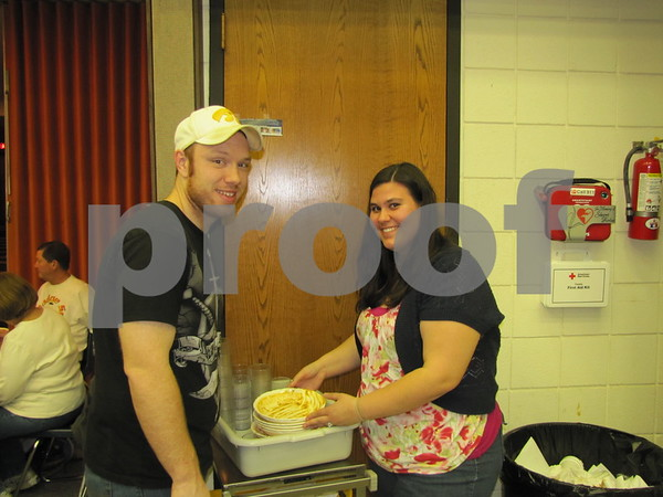 Matt and Leah Gaillard work together on clean-up duty at the Election Night Soup and Pie Supper.