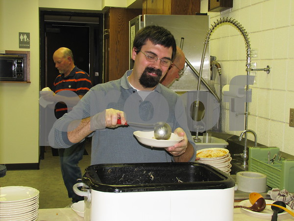 Pastor Joey Feldmann of First Congregational UCC church serves up some homemade soup at the church's annual fundraiser held on election night.