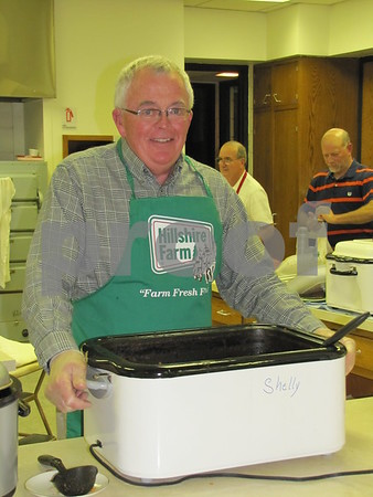 Dr. Tom Shelly assisted in the kitchen.