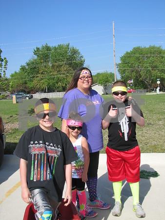 Mason Liska, Makayla Liska, Heather Liska, and Jaxson Lindstron are ready to participate in the Fun Run for FDSH track.