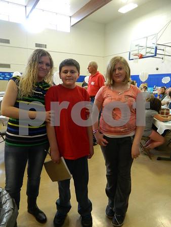 Left to right: Rebecca, Adam and Abby Alstott