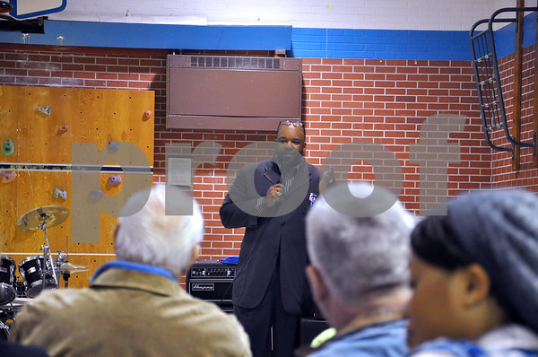 -Messenger photo by Joe Sutter<br /> <br /> The Rev. D.C. Darensbourg speaks at the AFES Inauguration Bash fundraiser in the gym. Darensbourg gave a speech by Frederick Douglass on freedom, and said Obama's reelection offered hope.