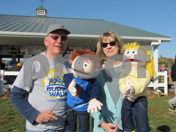 Doug and JoEllen Brightman pose with two of their puppets.  The Brightmans put on a puppet show earlier in the afternoon.