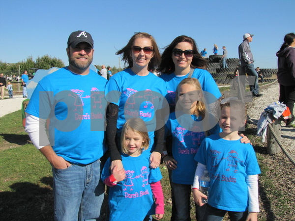 Tony and Amy Willard, and Chelsea Woodbeck, and their children were out to show support and participate in the Buddy Walk.