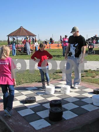 Playing the GIANT checker game were Reese Lemburg, Alexa Jeske, and Kyle Egemo.