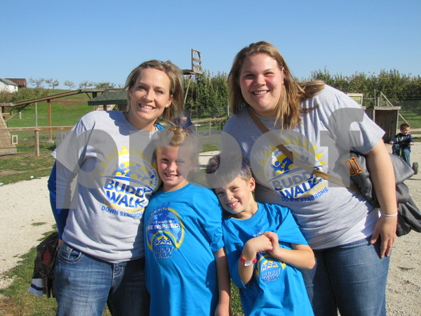 Sara, Rebekah, and Michael Buettner, and Ellie Garrelts enjoying all the activities at the Back 40 at the Buddy Walk event.