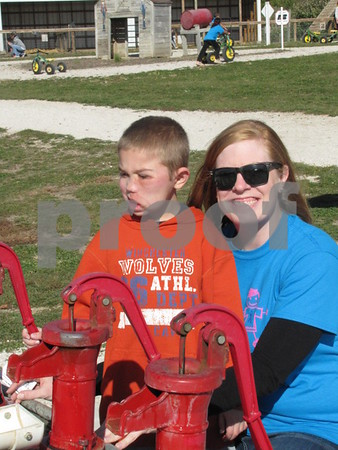 Beth Egemo and her nephew Sam Lemburg enjoyed the 'duck races' at the Back 40 during the Buddy Walk event.