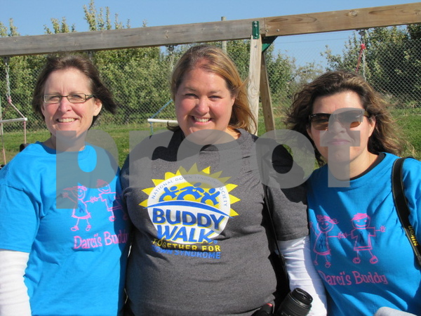 Stacy Osborn, Angie Anderson, and Dina Figueroa.  Anderson is a Board member of the Northwest Iowa Down Syndrome Society and mother of a child with Down Syndrome. Osborn and Figueroa were there to support their friend and the cause.