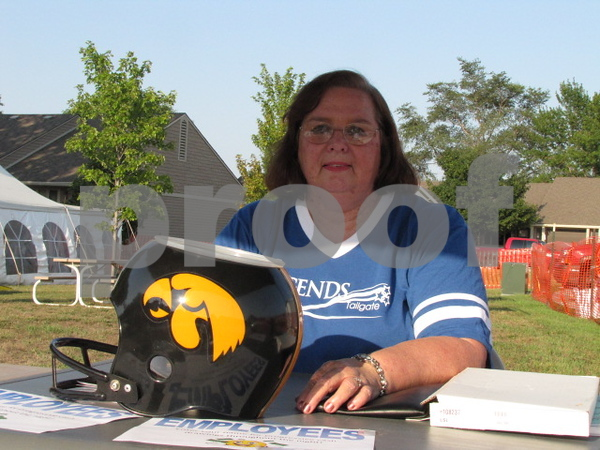 Linda George greeted attendees and took tickets at Friendship Haven's Legends Tailgate event.